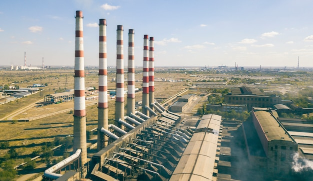 Industrial air pollution concept, factory near the city, aerial view f