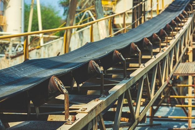 Industrial belt conveyor moving raw materials from mine gold