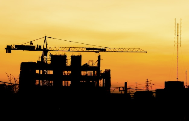 Industrial building construction cranes silhouettes