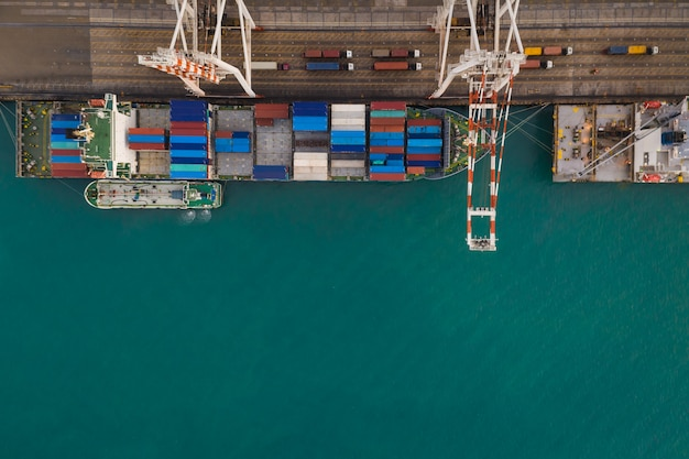 Industrial business international sea freight station by large cargo containers ship above view frome drone camera