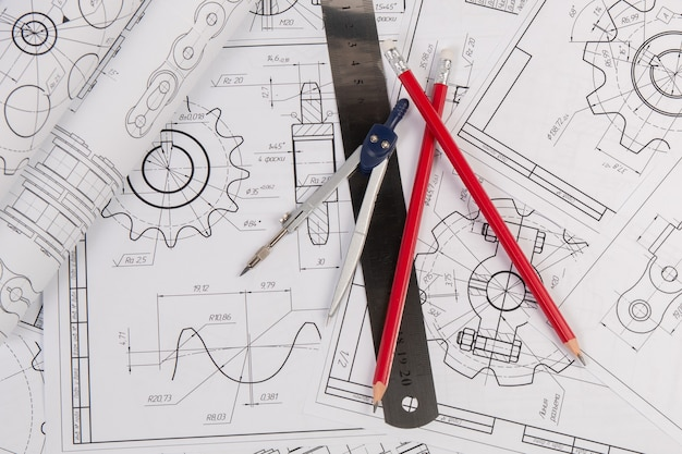 Industrial chain drawings, engineering compass, ruler and pencils