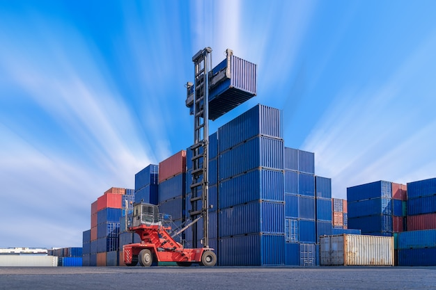 Industrial container yard logistic import export business, forklift truck handling cargo shipping container box in logistic shipping yard