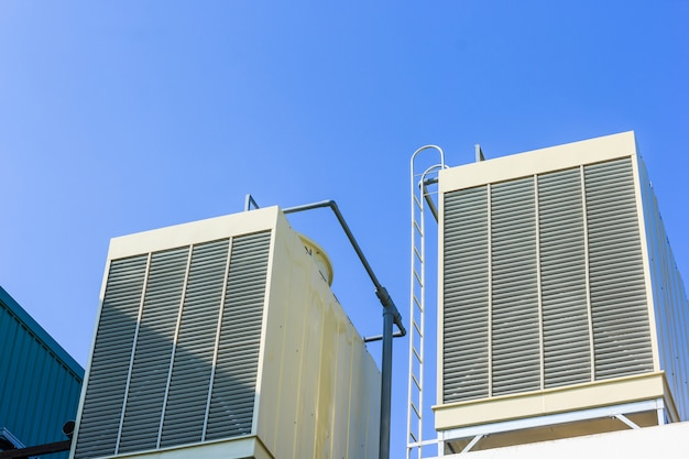 Industrial cooling towers or air cooled chillers on new building factory rooftop