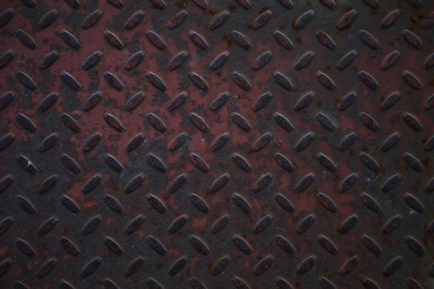 Industrial corrugated iron industrial texture for flooring. grunge metal diamond plate background. copyright space for site