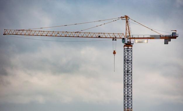 Industrial crane on blue sky