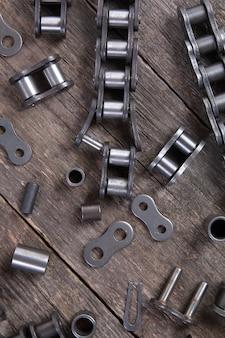 Industrial driving roller chain. part of the chain drive of machine-building mechanism.