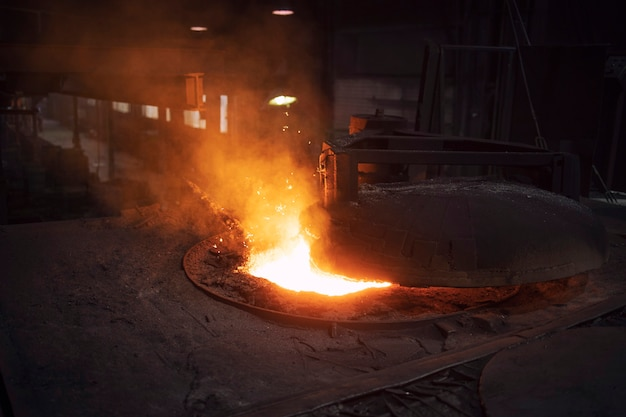Industrial electric arc furnace in foundry, iron being extracted out of ore for steel production.