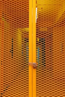 Industrial entrance, yellow grating steel door