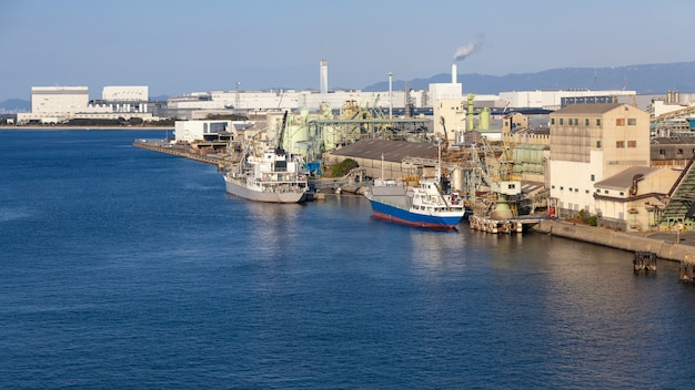 Industrial facilities and port and corgo ship osaka japan