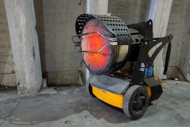 Industrial heater blowing hot air indoors.