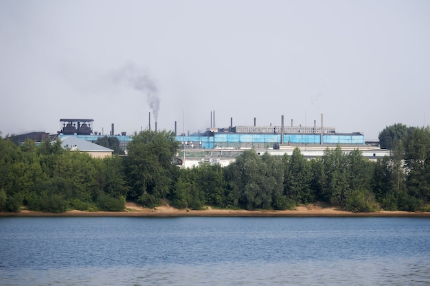 Industrial landscape with an factory on the banks of the river
