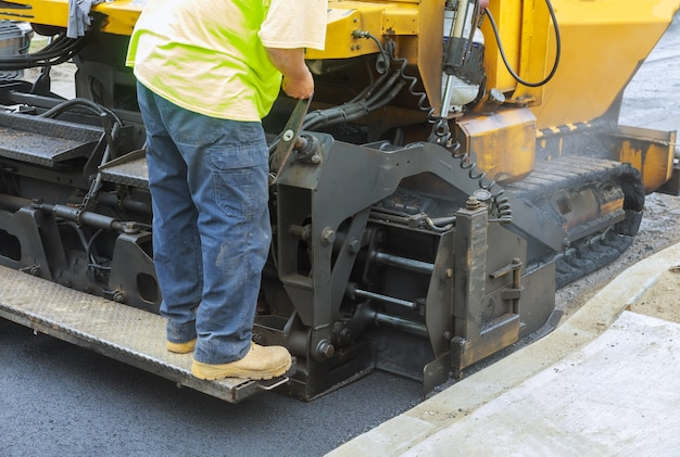 Industrial machinery working with asphal industrial laying fresh asphalt