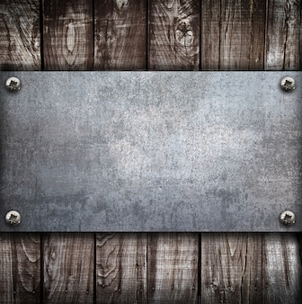 Industrial metal plate on wood
