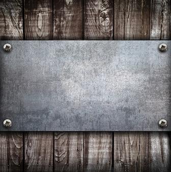 Industrial metal plate on wood