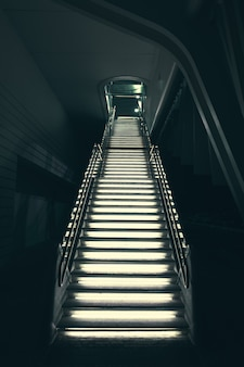 Industrial modern grey stone stairs illuminated with lights leading up
