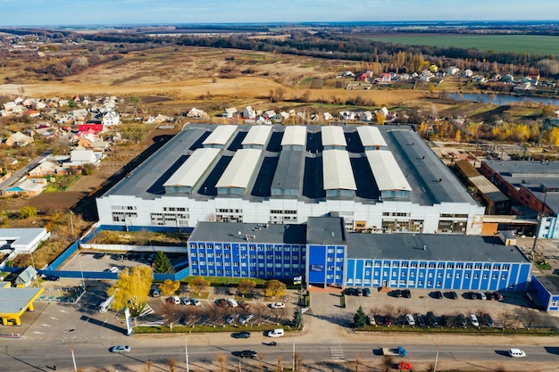 Industrial plant, machine building factory, aerial view, top shot on building, industrial zone, commercial site.