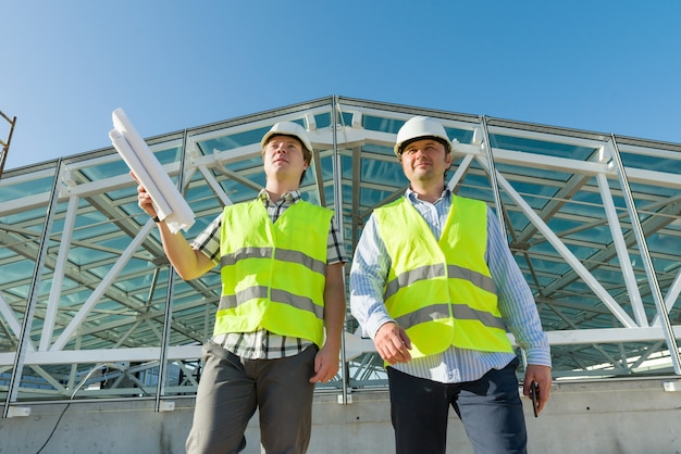 Industrial portrait of two men working at construction site