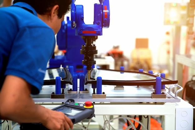 Industrial robot welding automotive part in car factory