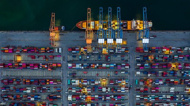 Industrial sea port working at night with container ship working at night,  aerial view container ship loading and unloading at night.