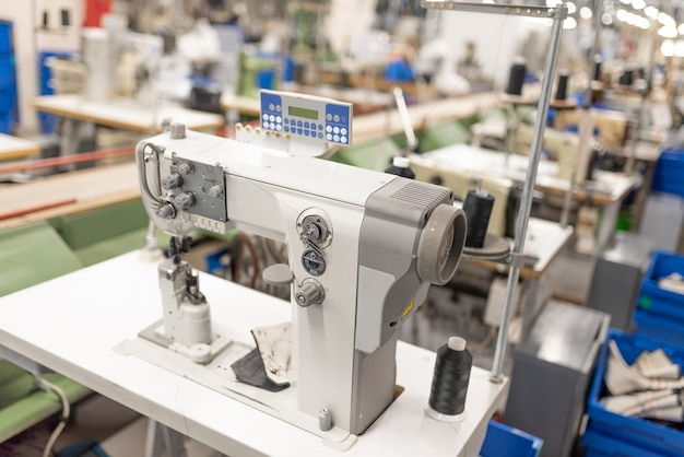 Industrial sewing machine in the work shop. shoe manufacturing. for any purpose.