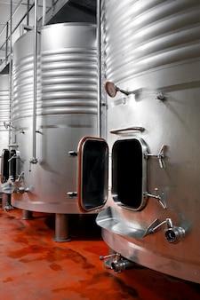 Industrial stainless steel vats in modern brewery.