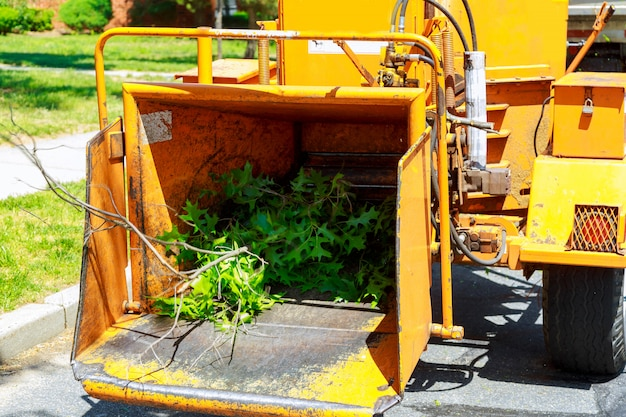 An industrial wood chipper at work