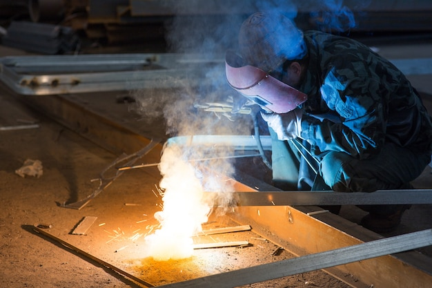 Industrial worker welding sparking