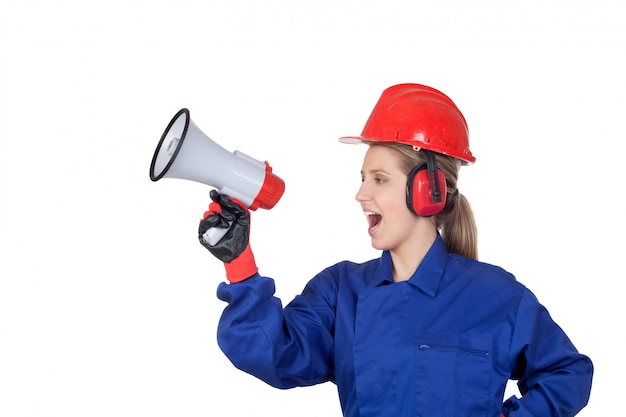 Industrial worker woman with a megaphone isolated on white background