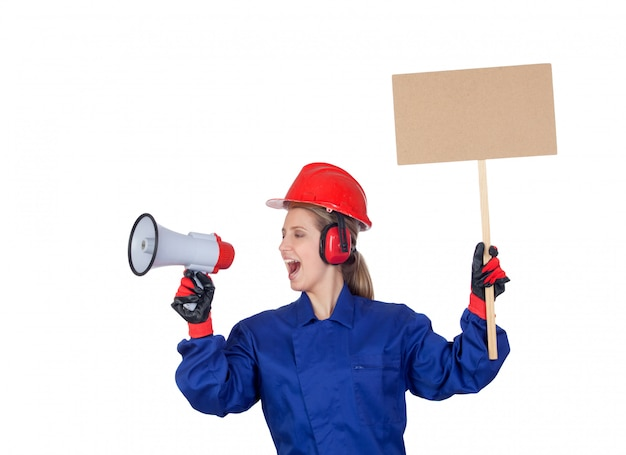 Industrial worker woman with a megaphone and a poster isolated on white background
