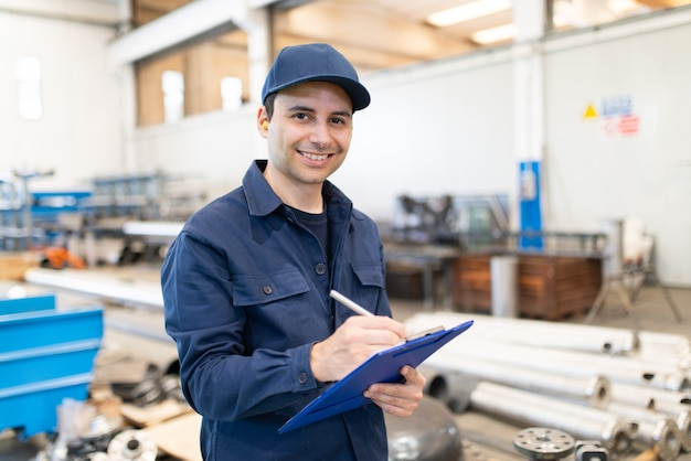 Industrial worker writing on a document