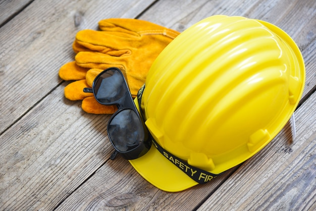Industrial yellow hat safety helmet, gloves and glasses