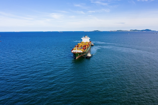 Industry business logistics cargo containers ship by the sea camera from drone aerial view