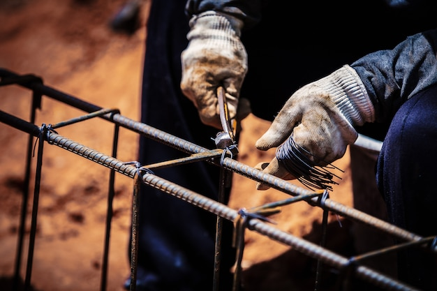 Industry construction site labor people worker wire steel bar
