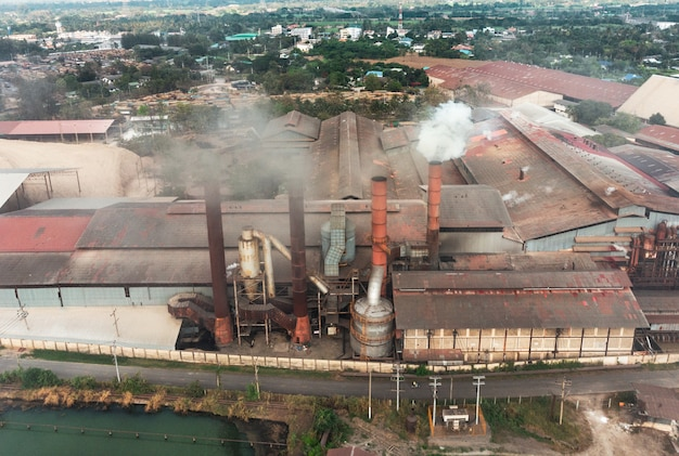 Industry factory manufacturing with emission smoke from chimneys