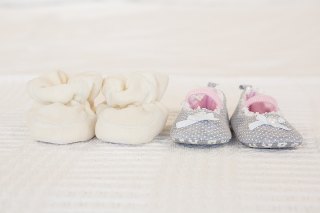 Infant shoes on bed