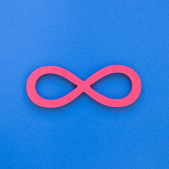 Infinite pink symbol on blue background