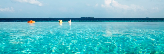 Infinity pool in maldives beauty in nature concept