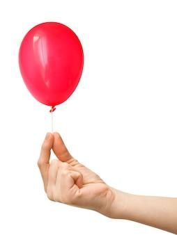 白い背景の上の膨脹可能なバルーンの手の写真