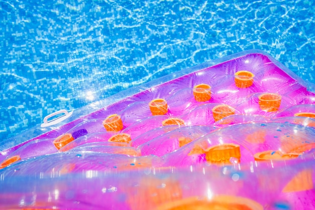 Inflatable floating mat in a pool in summer.