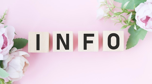 Info word on cubes on an old pink background . business concept.