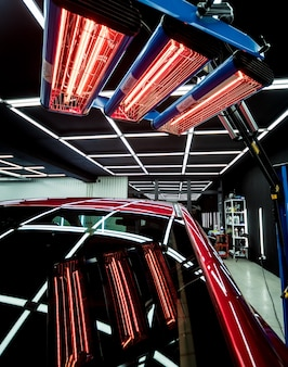 Infrared lamps for drying of car body parts after applying save gloss coating.