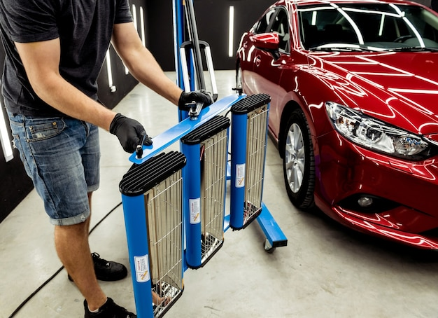 Infrared lamps for drying of car body parts after applying save gloss coating