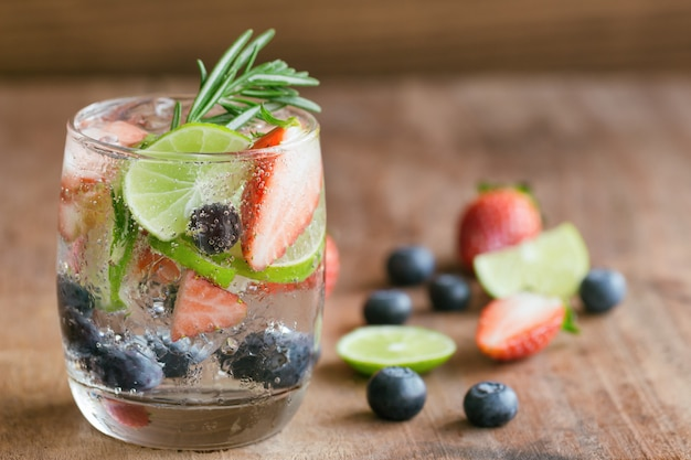 Infused water from blueberry strawberry and lemon in sparkling mineral water freshness
