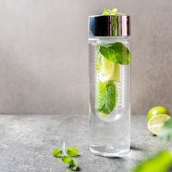 Infused water with lime and mint in special bottle
