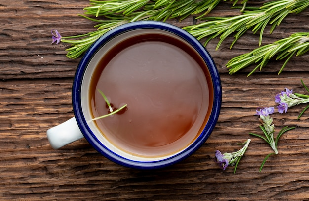 Infusion of rosemary (rosmarinus officinalis). ingredient of mediterranean cuisine and healing home remedy. rustic appearance.