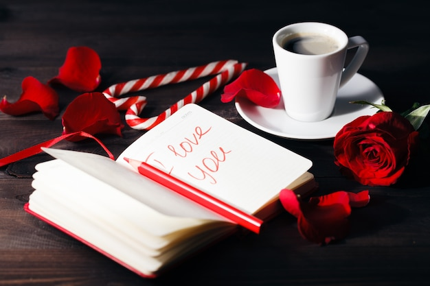 \ingle rose in a romantic setting.