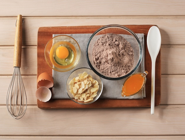 Ingredient of chocolate cake brownies in rural or rustic kitchen