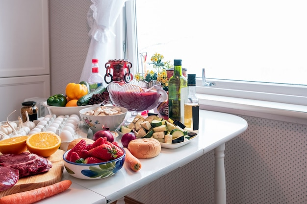 Ingredient with many foods, vegetables, fruits preparing for dinner on the dining table