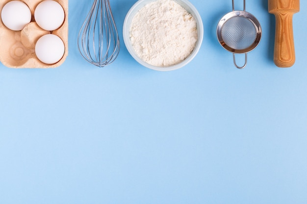 Ingredients for baking on a blue background