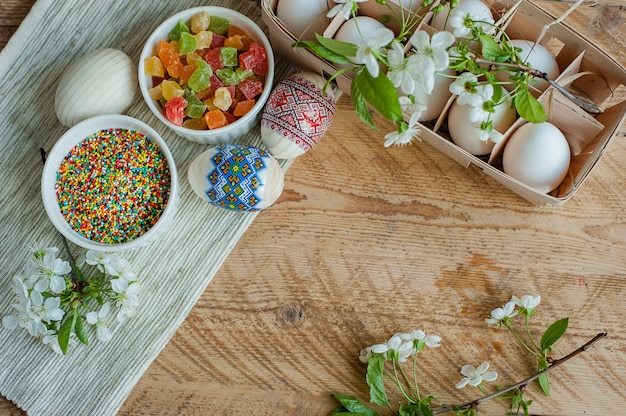 Ingredients for baking easter cake on wooden background